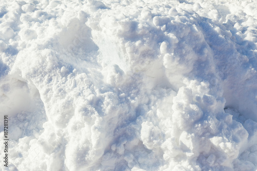 Foto Murales colose up of pile of soft and fluffy white snow on bright sunny day