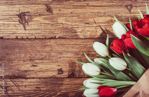 Spring flowers tulip on wooden background