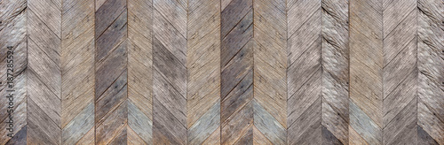 Dark brown rustic diagonal hard wood surface texture background,natural pattern backdrop,banner material for design. © weedezign