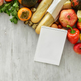 Top view set raw food notebook wooden background. Healthy food - 187290564