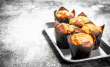 Muffins with honey and nuts on the board.