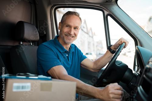 Delivery man driving van