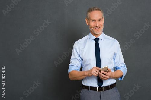 Foto Murales Senior businessman using phone