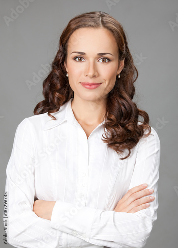 Sticker Smiling businesswoman, over gray