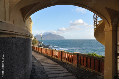 Fotobehang Liguria an arch in Bogliasco and paradise gulf in the background, Genoa province, Liguria, Italy