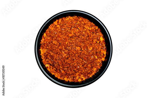 Foto op Canvas Hot chili peppers Hot red chili peppers powder in a black bowl isolated on white background
