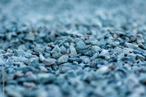 a chovel in a pile of grey gravel - 187307151
