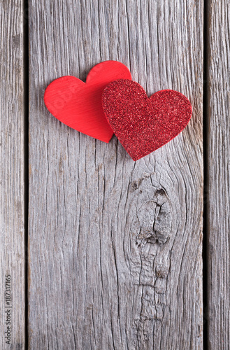 Valentine background with handmade glitter hearts on rustic wood