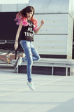 Jumping woman with pink hair