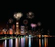 Chicago night skyline with fireworks, Usa.