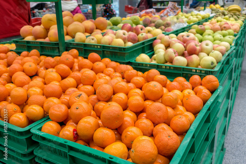 the display of fruit tangerines and apples