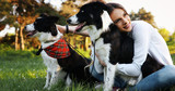 Romantic happy couple in love enjoying their time with pets - 187328766
