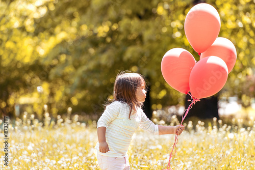 Portrait of little girl with balloons.