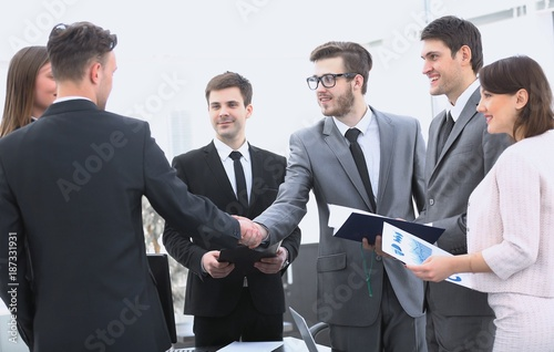handshake of business partners before the financial transaction - 187331931