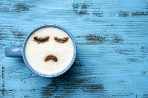 cup of cappuccino with a sad face - 187332551