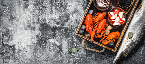 Different seafood on a wooden tray. - 187333129