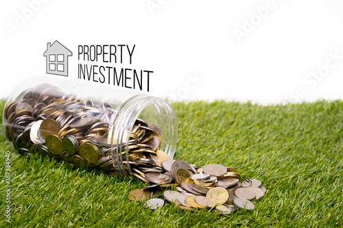 Saving for property investment. Money in a jar. Savings concept.