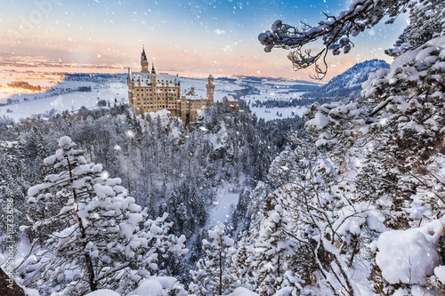 Fotobehang Natuur Neuschwanstein Castle during sunrise in winter landscape.