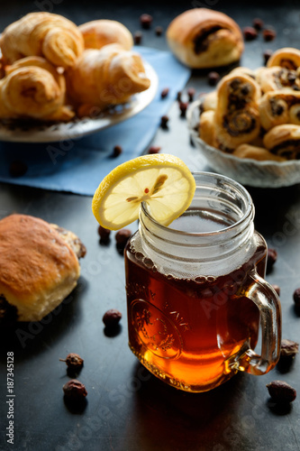 black tea with lemon in jar cup and biscuits - 187345128