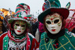 People in mask wearing carnival dress pose during the Venice Carnival