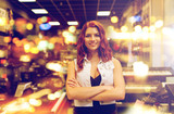 smiling assistant or customer at music store - 187346942