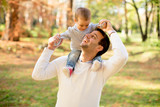 Young father and baby boy in autumn park - 187356163