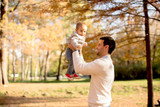 Young father and baby boy in autumn park - 187357703
