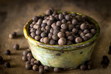 Allspice on rustic background - 187361390