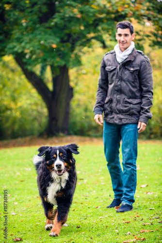 Man walking his dog in autumn park Poster