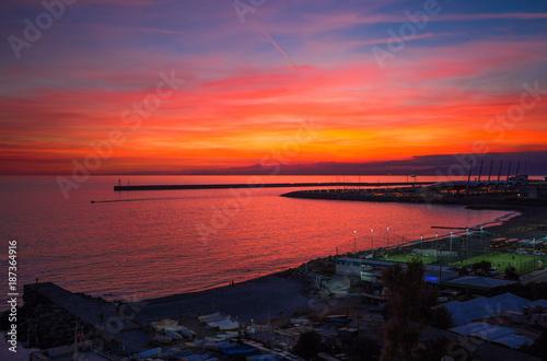 Poster Koraal Beautiful and colorful sunset in Genoa (Genova), Ligurian coast, Mediterranean sea, Italy
