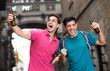 two male fans who are walking with beer
