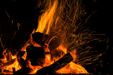 Burning firewood in the fireplace close up, BBQ fire, charcoal background. Charcoal fire with sparks - 187379183