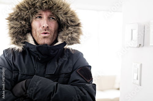 Foto Murales Man With Warm Clothing Feeling The Cold Inside House