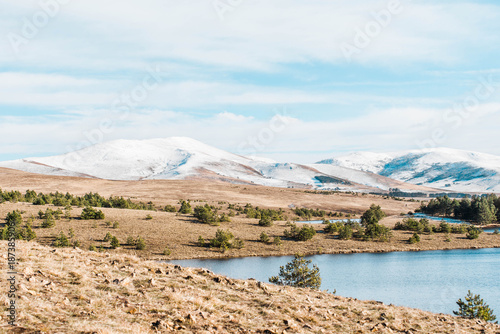 Fotobehang Wit nature landscape of showy mountains and lake water