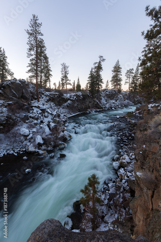 Dillon Falls of the Deschutes River flows during an icy sunrise in Central Oregon. - 187388748