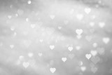 Beautiful abstract white colored hearts on blurry silver bokeh background.  - 187390100