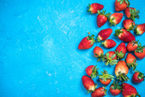 Market fresh ripe strawberries on blue vibrant background - 187392733