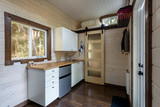 Interior design of a cozy kitchen in a tiny rustic log cabin. - 187394193