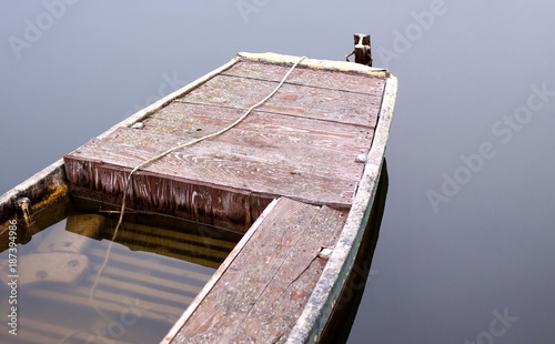 Foto op Canvas Schipbreuk Stranded, flooded boat on the shallow lake