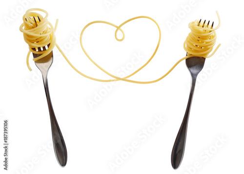 Swirls of cooked spaghetti with fork. Spaghetti heart shape. - 187395106