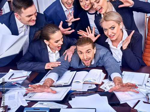 Business people office. Team people are unhappy with their leader. Intern man manager does not cope with his duties. Crowd in stress throw up their chief's papers. Too many new ideas.