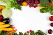 Flat lay of vegetable and fruits with empty space of white background on middle, Top view. Vegetarian, diet food, grocery fresh produce and healthy eating concept. - 187428788