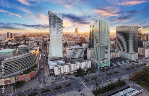 Fototapeta Warsaw city with modern skyscraper at sunset, Poland