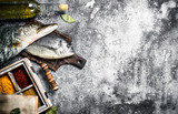 Fresh unprepared fish with spices. - 187430502