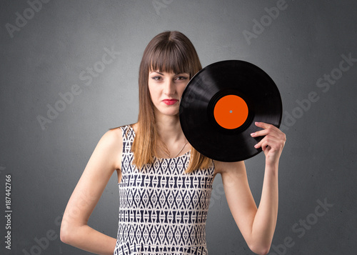 Lady holding vinyl record - 187442766