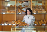 a baker in her bakery - 187443923