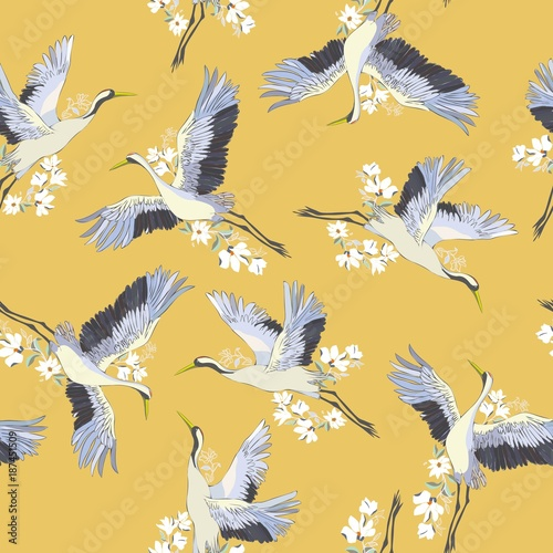 Japanese seamless pattern of birds and water. Traditional vintage fabric print. White and blue indigo background. Kimono design. Monochrome vector illustration. © Vladimir