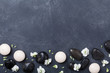 Spa composition decorated flowers on black stone background top view. Beauty treatment, aromatherapy and relaxation concept. Flat lay. .