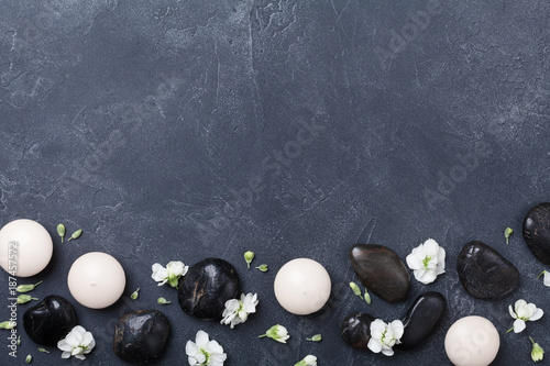 Spa composition decorated flowers on black stone background top view. Beauty treatment, aromatherapy and relaxation concept. Flat lay. . - 187457572