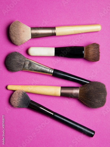 Makeup cosmetic blusher brushes on a pink background - 187458711